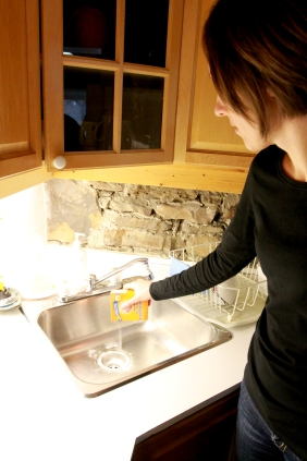 Pour baking soda into the sink